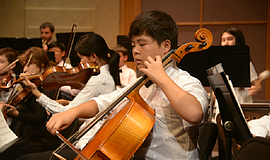 Promotional photo of a San Diego Youth Orchestra member performing.