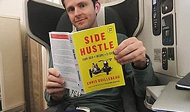"Photo of the author with ""Side Hustle,"" the book that he will be discussing. ..."
