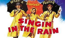 "A promotional poster for the film ""Singin' in the Rain."""