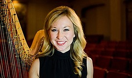 A photo of harp player Julie Smith Phillips, courtesy of San Diego Symphony.
