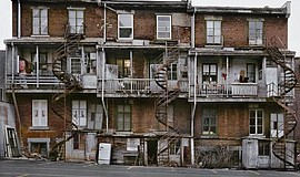 A photograph by Wayne Sorce titled Spiral Fire Escapes, Chicago, 1975. Courte...