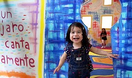 A child at The New Children's Museum.