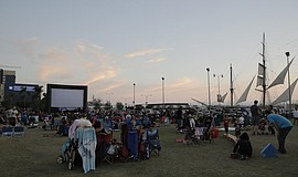 Community members watch a movie at the park.