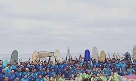 Promotional photo of surfers attempting the world record breaking 1 Wave Chal...