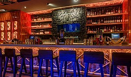 Photo of the bar at The Grass Skirt.