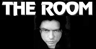"""A promotional poster for """"The Room,"""" courtesy of Landmark..."""
