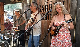 Photo of the featured artists performing at Nate's Garden Grill. Courtesy of ...