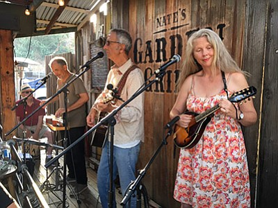 Photo of the featured artists performing at Nate's Garden Grill. Courtesy of Tinkersmith.