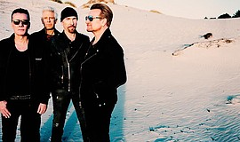 Promotional photo of U2.
