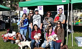 Promotional photo of volunteers and No Wagging Tail Left Behind Animal Rescue...