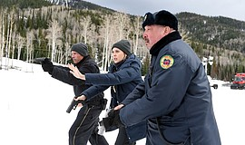 Graham Greene, Hugh Dillon, and Elizabeth Olsen in Wind River (2017).
