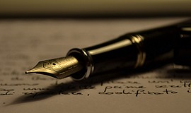 A stock photo of a pen and paper.