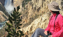 Photo of hiker at Yellowstone National Park, courtesy of Road Scholar.