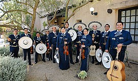 Photo of the featured performers. Courtesy of Mariachi Es...
