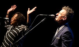 Photo of Lyle Lovett performing with Francine Reed of his...