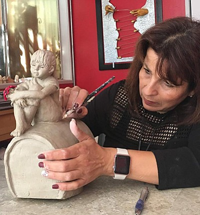 Photo of sculptor Sana Saadeh working on a new piece. Cou...