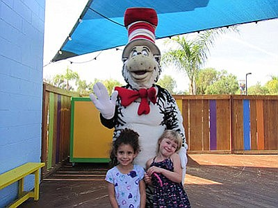 Promotional photo of The Cat in the Hat with kids for Hat...