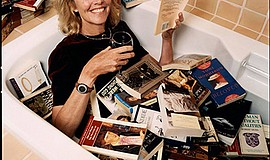 Promotional photo of Jane Smith in tub of books. Courtesy...