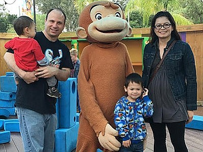 A family meets Curious George. Promotional photo for the ...