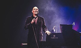 Photo of Mike Garson performing. Courtesy of A Bowie Cele...