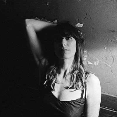 Promotional photo of Nicki Bluhm. Courtesy of the Belly U...