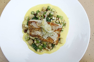 Promotional photo of the The Prado's pan roasted seabass....