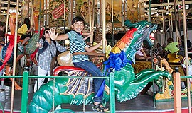 Promotional photo of child on carousel. Courtesy of the F...