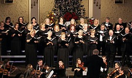 Photo of Pacific Coast Chorale performing with an orchest...