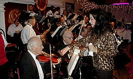 Photo from a previous performance by the featured musicia...