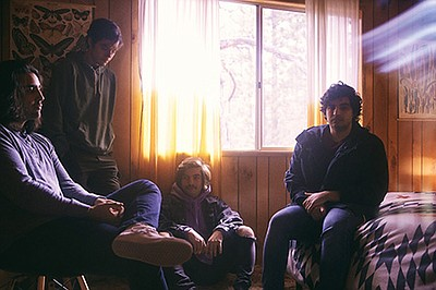 Promotional photo for Chon & Between The Buried And Me wi...