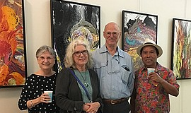 Promotional photo of people at Encinitas Art Night. Court...