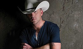 Photo of the performing artist, Justin Moore. Courtesy of...