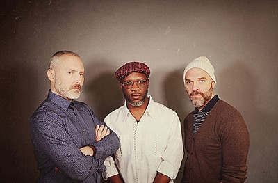 A promotional photo of the jazz trio The Bad Plus, courte...