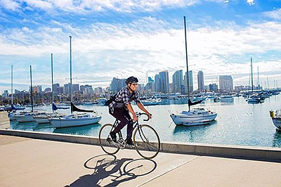 Promotional photo of man biking along the water. Courtesy...