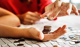 Promotional photo of a person counting coins. Courtesy of...