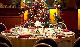 Promotional photo of a dinner table with Christmas decora...