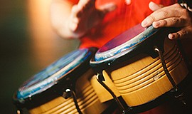 Promotional photo of bongo drums for Congas and Bongos ev...