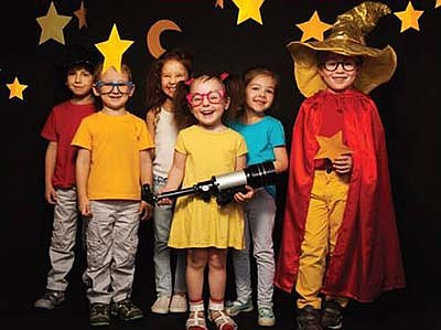 Promotional photo of children posing with hanging stars f...