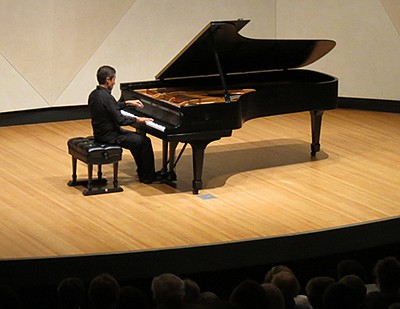 Promotional photo of pianist Gustavo Romero performing in...