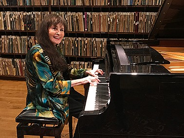 Promotional photo of Jacquelyne Silver playing the piano....