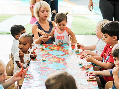 Promotional photo of children at snack time for Little Le...