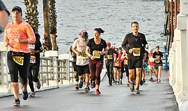 Promotional photo of athletes running in the O'Side Turke...