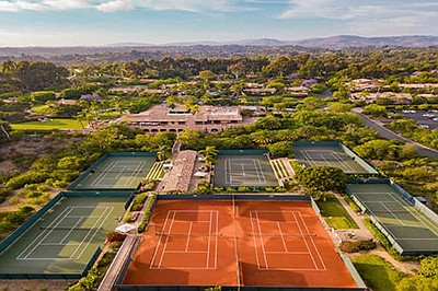 Promotional photo of tennis courts at Rancho Valenica. Co...