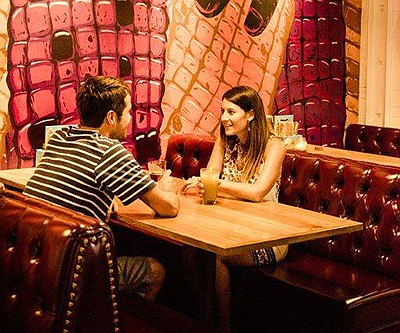 Promotional photo of a couple dining at Galaxy Taco. Cour...