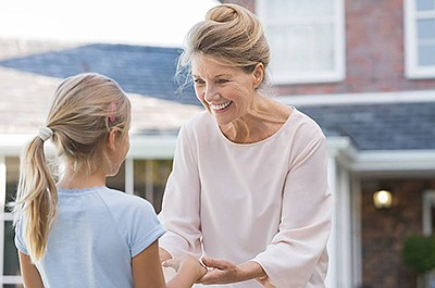 Promotional photo of a woman and child for CASA Volunteer...
