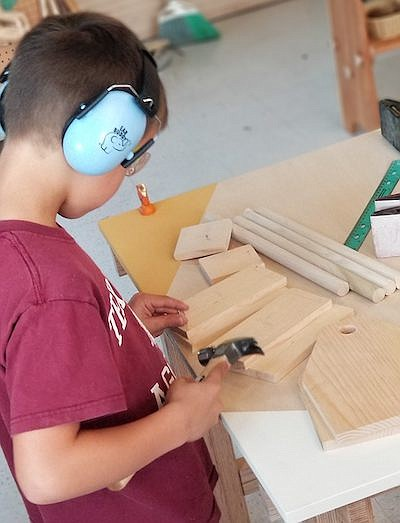 Promotional photo of a kid doing woodworking. Courtesy of...
