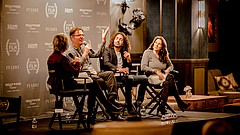 Promotional photo of a discussion panel. Courtesy of San Diego International ...