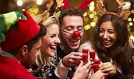 Promotional photo of people dressed in holiday attire. Co...
