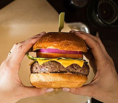 Promotional photo of a burger. Courtesy of 7 Mile Kitchen...