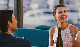 Promotional photo of couple sitting outside at restaurant...